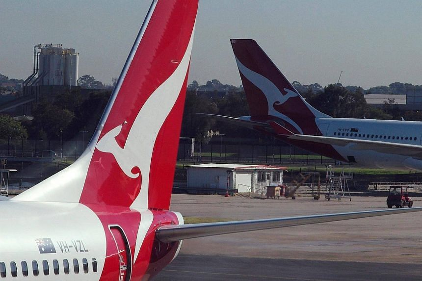 Qantas aircraft are pictured on the tarmac of Sydney Airport.