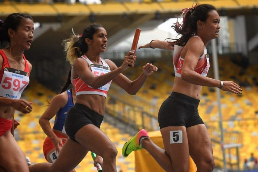 Shanti Pereira passes the baton to anchor runner Nur Izlyn Binte Zaini during the SEA Games women's 4x100 relay on Aug 25, 2017.