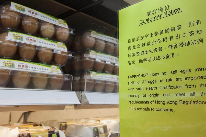 A customer notice advising that eggs for sale in a supermarket in Hong Kong are safe for consumption, on Aug 12, 2017.