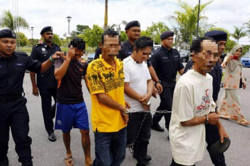 Police escorting the four family members out of court on Friday (Aug 25).