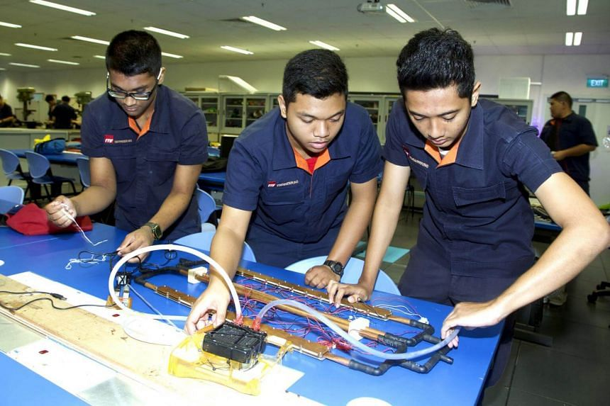 ITE College West students (from left) Izzat Mahad, Mohd Asyraf Mohd Zailani and Ahmad Irfan Muhd Sharif doing a project which transform heat energy into electrical energy to activate a cooling system which will make the roads less hot.