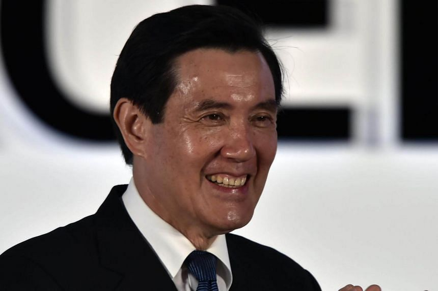 Taiwanese President Ma Ying-jeou applauding at a local designing awards ceremony in Taipei on April 21, 2016.