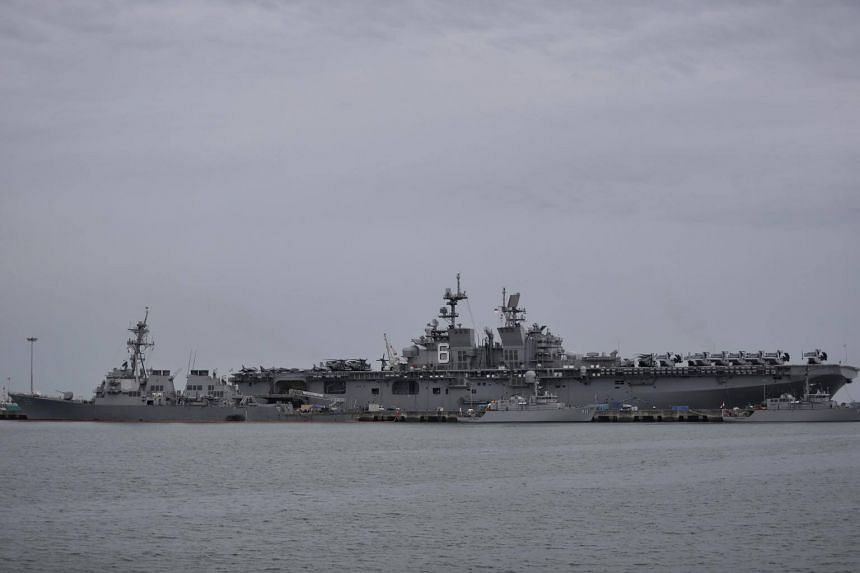 The USS John S McCain (left) seen in front of a helicopter carrier in Changi Naval Base on Aug 22, 2017.