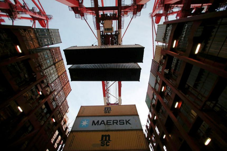 Containers are seen unloaded from the Maersk's Triple-E giant container ship Maersk Majestic, one of the world's largest container ships, at the Yangshan Deep Water Port in Shanghai.