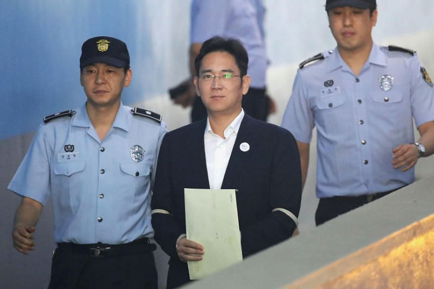 Lee Jae Yong arrives at the Seoul Central District Court to hear the bribery scandal verdict on Aug 25, 2017.