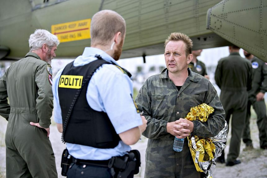 Peter Madsen (right) talks to a police officer, Aug 11, 2017.