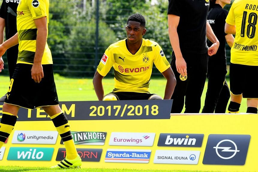 Ousmane Dembele siting for the Dortmund team photo, Aug 9, 2017.