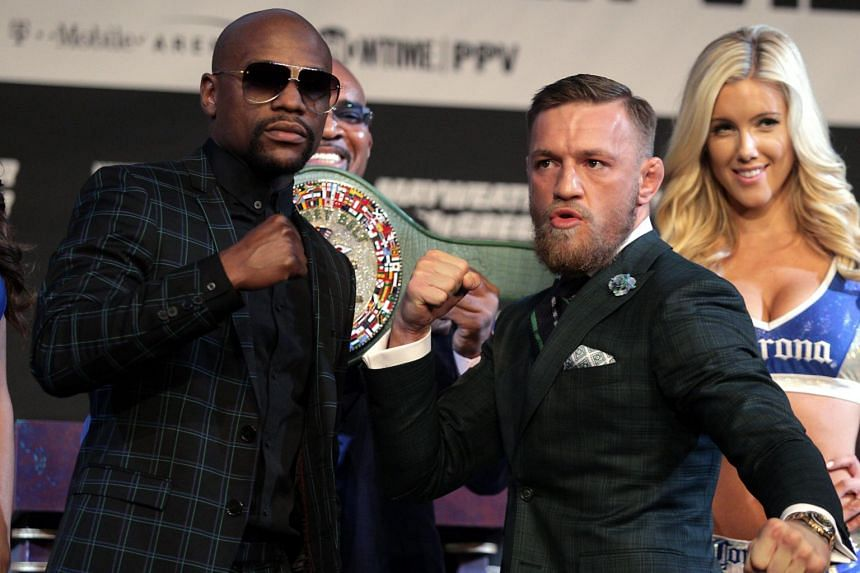 Boxer Floyd Mayweather Jr. (left) and MMA figher Connor Mcgregor pose during a media press conference at the MGM Grand in Las Vegas, on Aug 23, 2017.