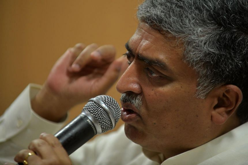 Nandan Nilekani gesturing as he addresses a press conference in Bangalore.