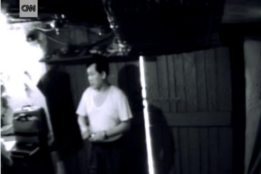 The grainy surveillance video was filmed on July 27, 2011, on a hidden camera set up within a garage to capture the end of a sting operation that was planned ahead.