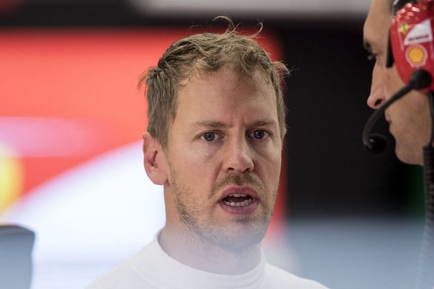 Vettel reacts during the second practice session.