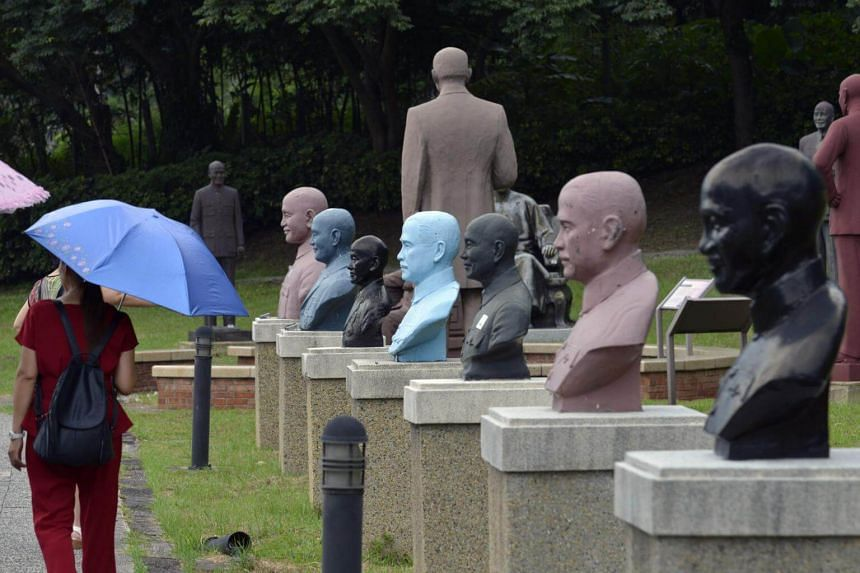 Tourists walking past statues of the late nationalist leader Chiang Kai-shek at a park in Taoyuan, northern Taiwan.