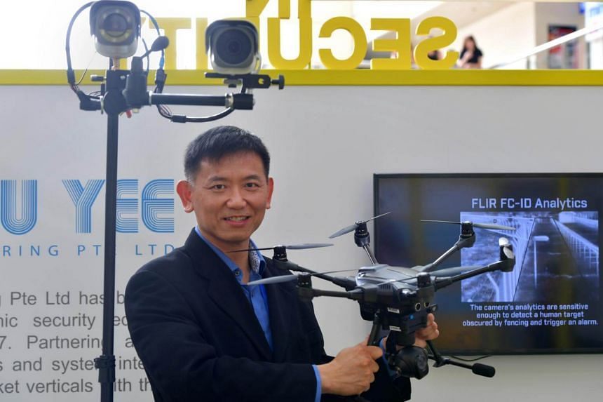 Mr Oliver Ong, assistant general manager of Dou Yee Engineering, poses with a smart drone that operates autonomously.