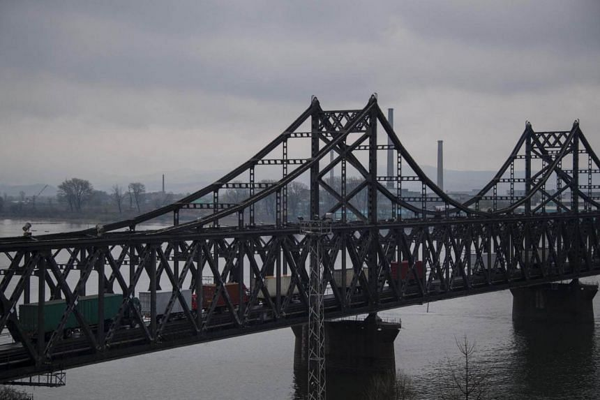 Trucks crossing the China-North Korea Friendship Bridge. A notice from China's commerce ministry said that applications for new or expanded investment in North Korea by Chinese companies would be rejected.