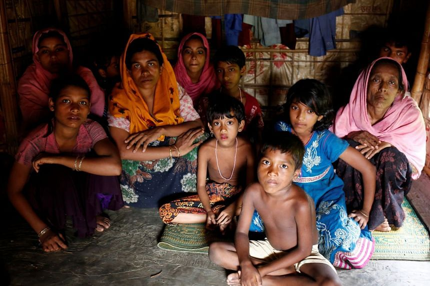 Rohingya refugees take shelter at a makeshift camp, after crossing the Myanmar-Bangladesh border.