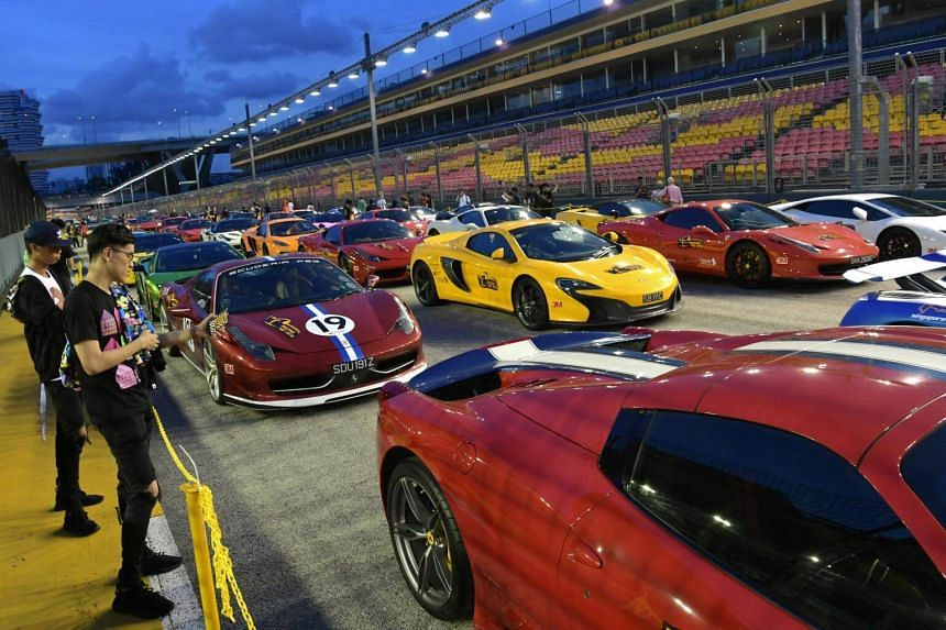 Cars on display at the starting grid near the F1 Pit Building for the Racing Hearts Charity Drive on Aug 26.