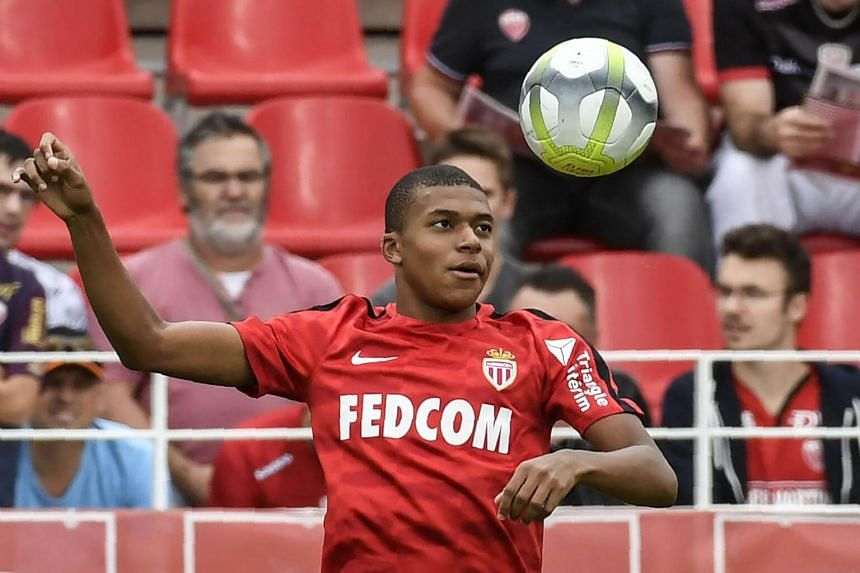 Kylian Mbappe warms up before the French Ligue 1 football match between Dijon FCO and AS Monaco, on Aug 13, 2017.