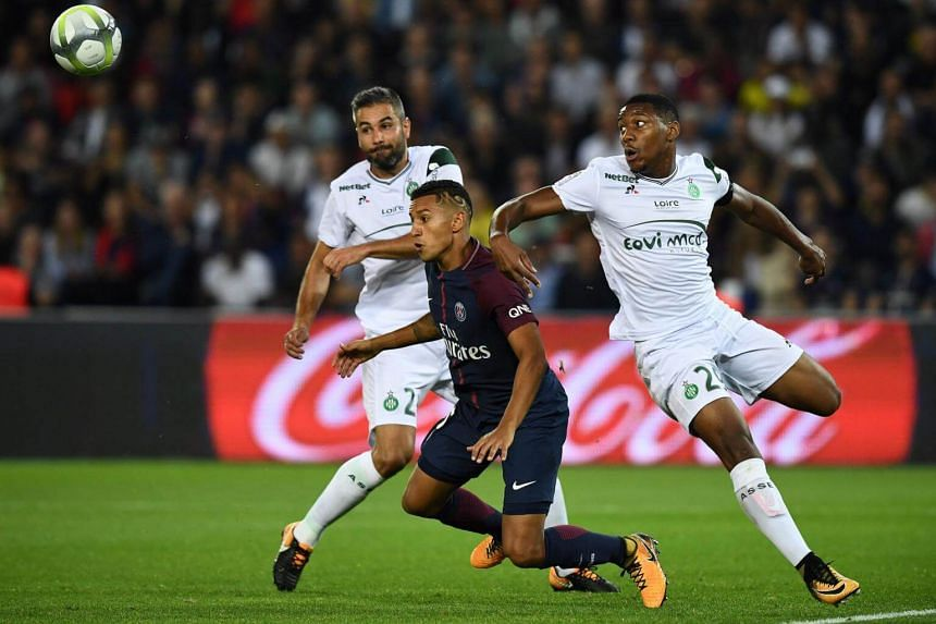 Marquinhos (centre) vies for the ball with Loic Perrin (left) and Ronael Pierre-Gabriel at the Parc des Princes stadium in Paris, on Aug 25, 2017.