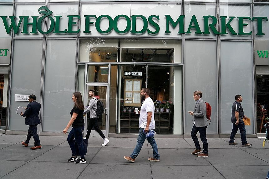 A Whole Foods Market in New York. Amazon said it will be reducing prices at the grocer's after taking over next Monday.