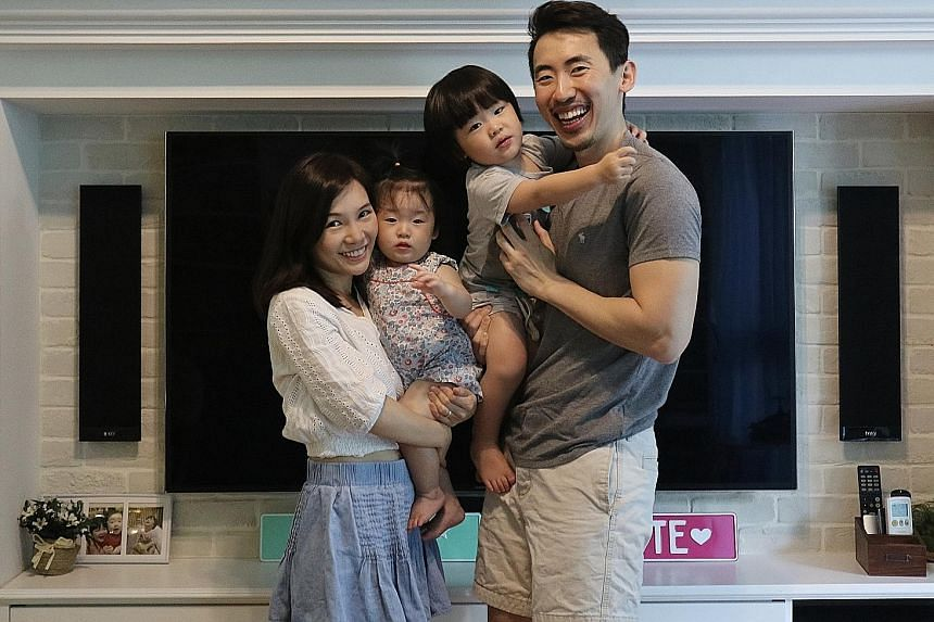 Blue tiles, to replicate the hues of the sky and the ocean, as well as sand-textured walls re-create the Maldivian beach villa vibe in the master bathroom (above). Home owners Kenneth Tan and Jael Tan (both left) with their children, Odette, one, and