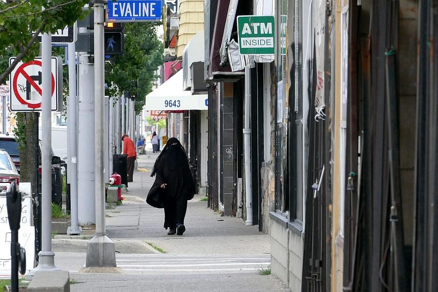 Burqa-clad women and men with Islamic caps are common sights in Hamtramck. Its biggest communities are from Yemen and Bangladesh. Its once-dominant Polish community is down to 10 per cent of the population. From top: Mr Greg Kowalski, chairman of the