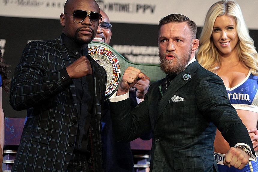 Boxer Floyd Mayweather Jr (far left) and mixed martial arts star Conor McGregor pose during a media press conference at the MGM Grand Las Vegas.