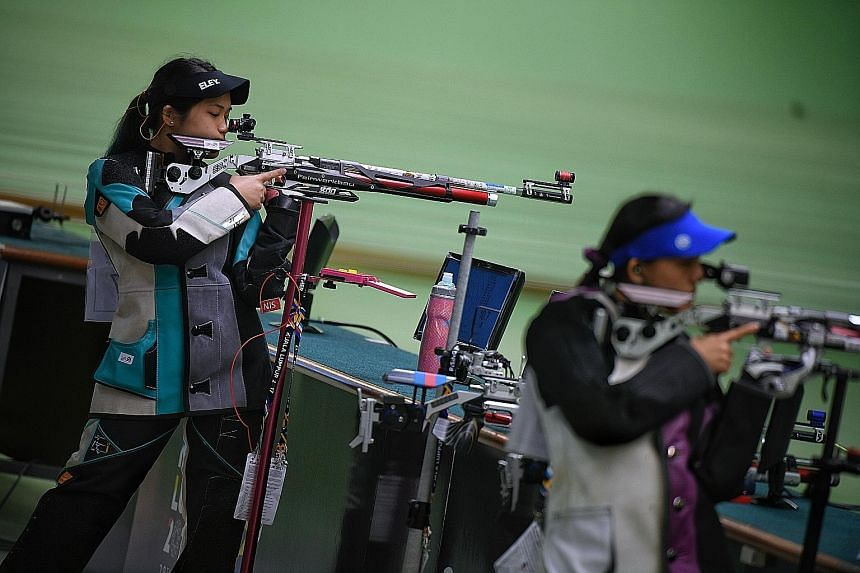 Martina Veloso (left) competing against fellow Singaporean Jasmine Ser after the 10m air rifle field was whittled down to two. Veloso scored 10.8 with her last shot to win.