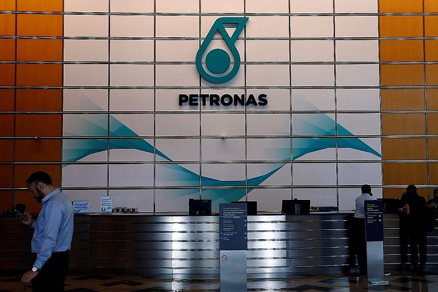 Petronas, Malaysia's only Fortune 500 company, will pay the government RM16 billion (S$5 billion) this year, up from its earlier commitment of RM13 billion, says its chief executive officer Wan Zulkiflee Wan Ariffin.