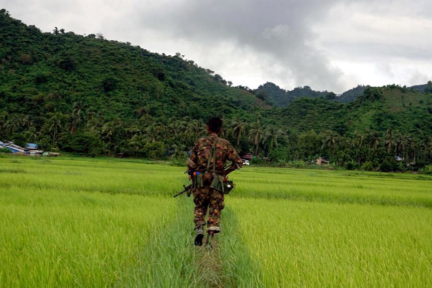 Myanmar soldier walks in ChainKharLi Rakhine ethnic village, an area close to the fighting at Rathedaung township of northern Rakhine State, on Aug 25, 2017.