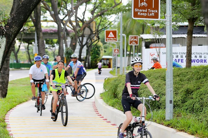 Cyclists using the new 15km cycling path network in Jurong Lake district on July 1, 2017.