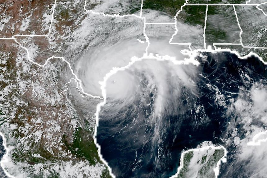 This National Oceanic and Atmospheric Administration satellite image taken shows Hurricane Harvey (left) approaching the coast of Texas, on Aug 25, 2017.