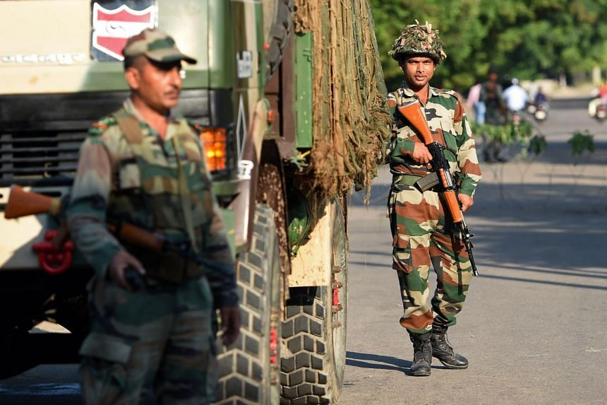 Indian soldiers stand guard at Panchkula on Aug 26, 2017.