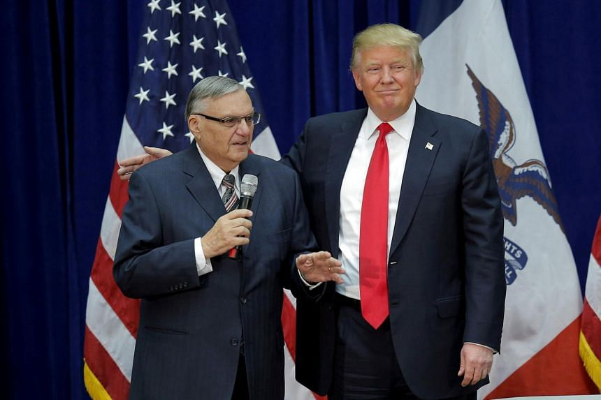 US Republican presidential candidate Donald Trump is joined onstage by Maricopa County Sheriff Joe Arpaio at a campaign rally in Marshalltown, Iowa, US on Jan 26, 2016.