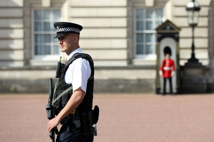 A police officer patrols within the grounds of Buckingham Palace in London, Aug 26, 2017.