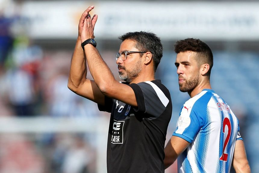 Huddersfield Town manager David Wagner applauds fans after the match.