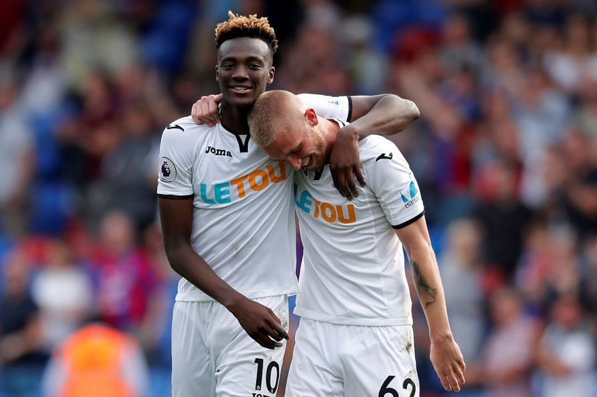 Swansea City's Tammy Abraham celebrates after the match with Oliver McBurnie.