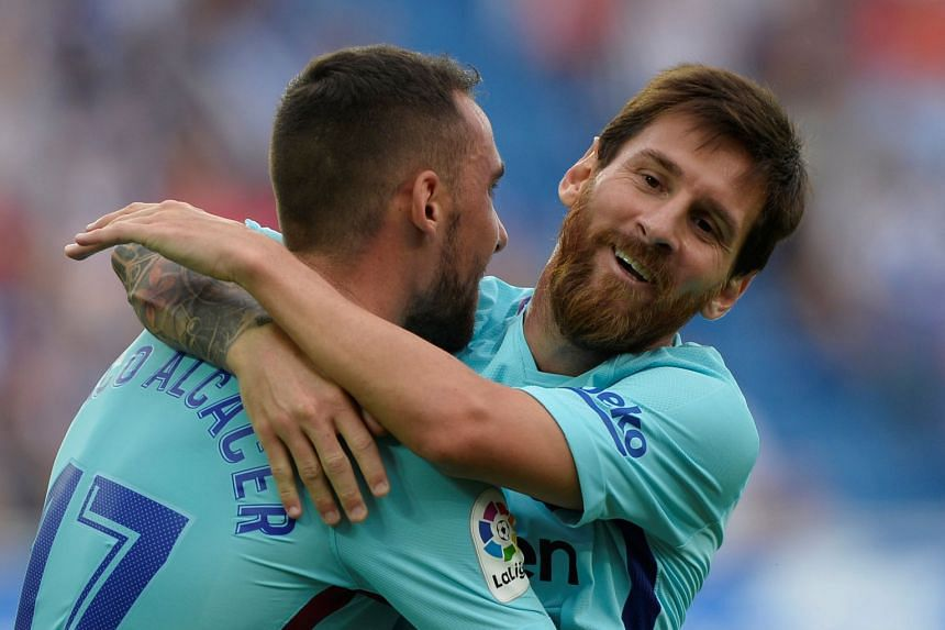 Barcelona's Lionel Messi celebrates scoring their second goal with Paco Alcacer.