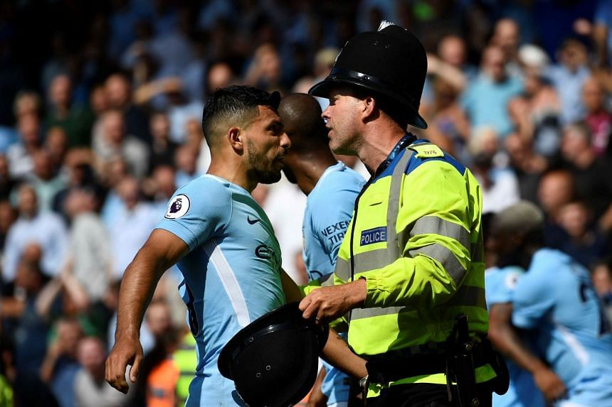 Manchester City's Sergio Aguero with police after Raheem Sterling celebrates scoring their second goal.