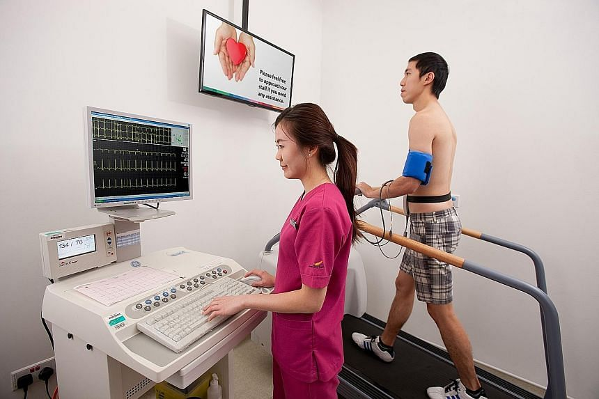 A patient undergoing an exercise stress test at the National Heart Centre Singapore. Not only do more men develop cardiovascular diseases than women, but women here also develop the diseases about 10 years later than men.