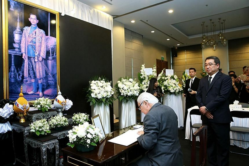 Dr Tan signing the condolence book for Thailand's King Bhumibol Adulyadej at the Royal Thai Embassy, where he went upon returning from Norway last October.