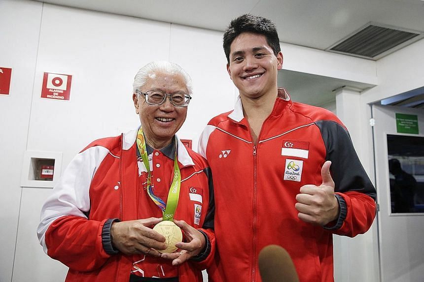 President Tony Tan wearing the Olympic gold medal won by Joseph Schooling after the 2016 Rio Olympics men's 100m butterfly final at the Olympic Aquatics Stadium in Rio de Janeiro, Brazil.