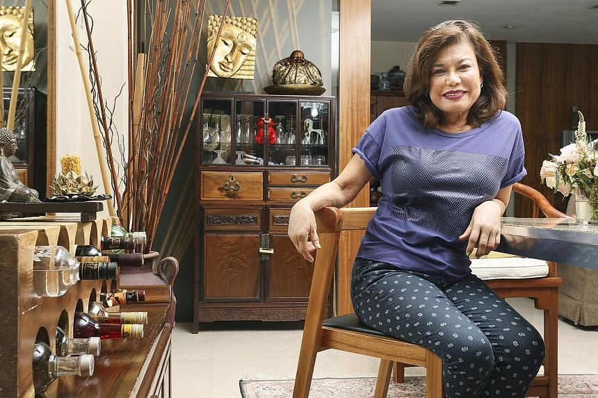 Dr Carol Balhetchet's events management business was so lucrative that she once splurged a high five-figure sum on an antique Chinese chest (behind her) that captured her fancy. The chest is a reminder to her that hard work pays off.