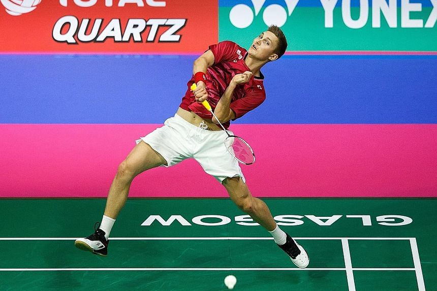 Denmark's Viktor Axelsen hits a return to China's Chen Long in the World Championships semi-final. The Dane won 21-9, 21-10 to reach the final for his first time.