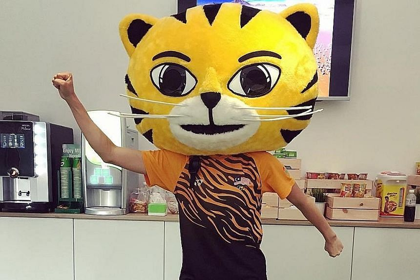 Malaysian diving world champion Cheong Jun Hoong was raring to go on the first day of the diving competition yesterday. Mascot duty in the Rimau suit appears to be one reason she will be taking part in only one event at these Games.