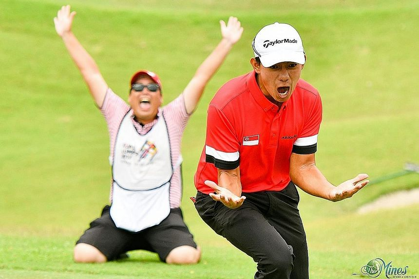 Marc Ong and his caddie celebrating after Singapore won the sudden- death play-off in the team event against Thailand.