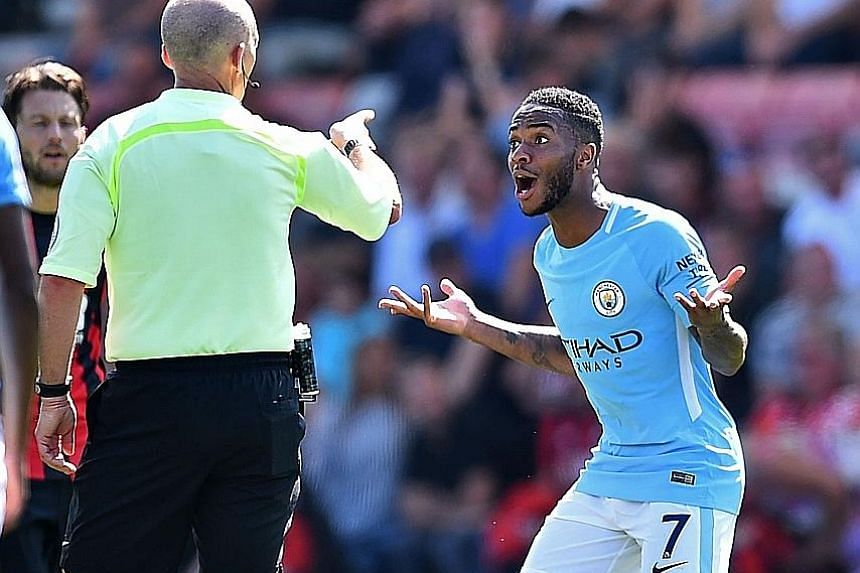 Manchester City's Raheem Sterling is bewildered after receiving a second yellow card from referee Mike Dean for going into the crowd to celebrate his 97th-minute goal yesterday.