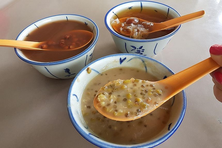 The desserts, which include (clockwise from above left) red bean soup, cheng tng and green bean soup, cost 90 cents a bowl.