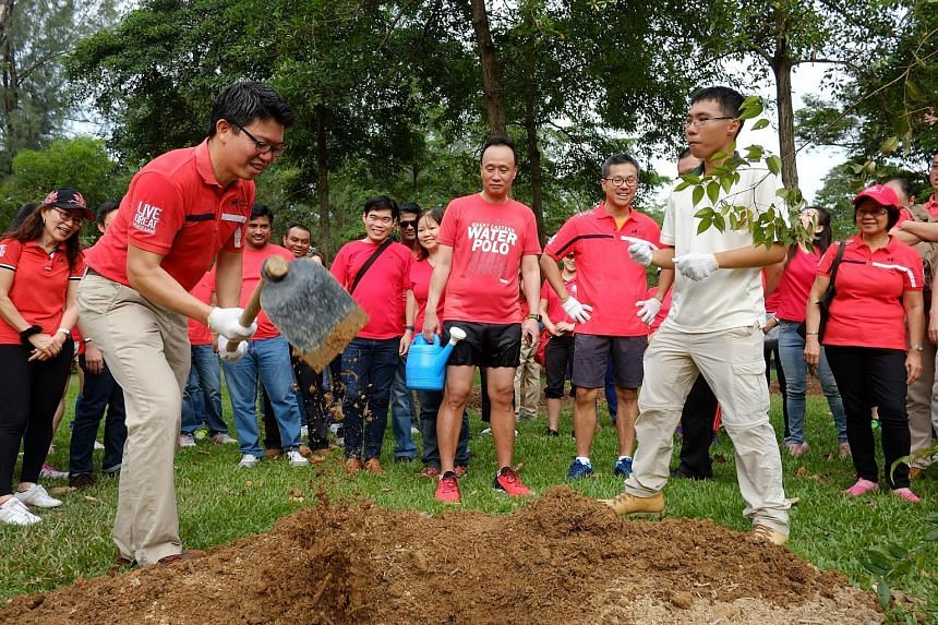 Insurer Great Eastern marked its 109th birthday by having 109 staff, distribution representatives and executives plant 50 endangered native trees at East Coast Park yesterday. They include Mr Colin Chan (with hoe), group marketing managing director;
