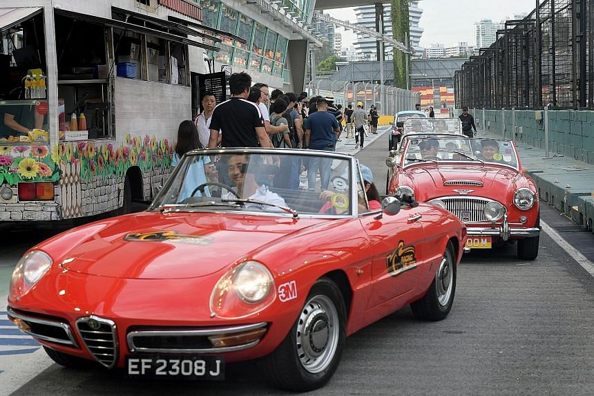 Some of the more than 100 vintage and supercars taking part in the first Racing Hearts charity drive yesterday. The passengers included more than 100 Community Chest beneficiaries.