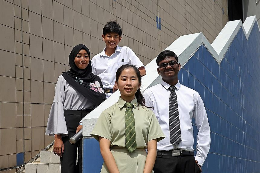 Hard work pays for (from left) Zuhairiena Zakaria, 17; Hans Gerhard Van Huizen, 13; Diana Chia, 17; and T. Pravin, 17. They are among 743 PSLE, GCE N- and O-level students who received book vouchers.